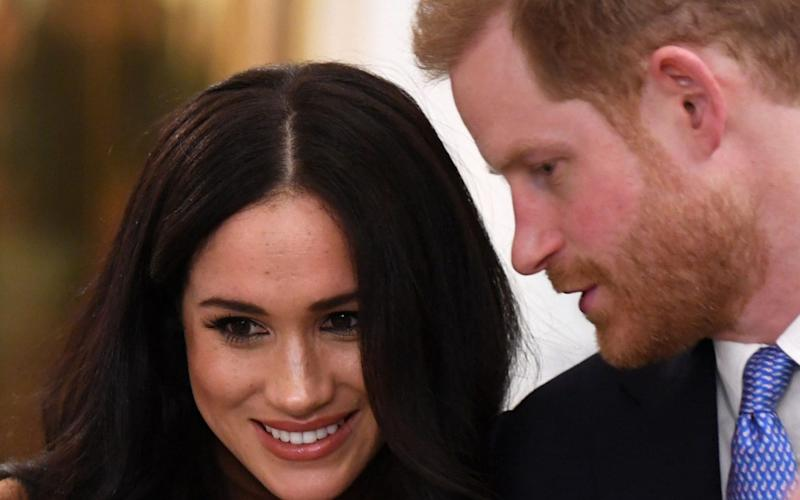 Meghan and Harry are stepping back as senior members of the Royal Family - AFP