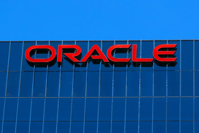 The Oracle logo is shown on an office building in Irvine, California