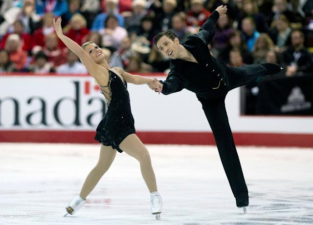 Kirsten Moore-Towers and Dylan Moscovitch perform their free program in pairs competition at the Canadian Skating Championships Saturday Jan. 11, 2014 in Ottawa, Ontario. (AP Photo/The Canadian Press, Adrian Wyld)
