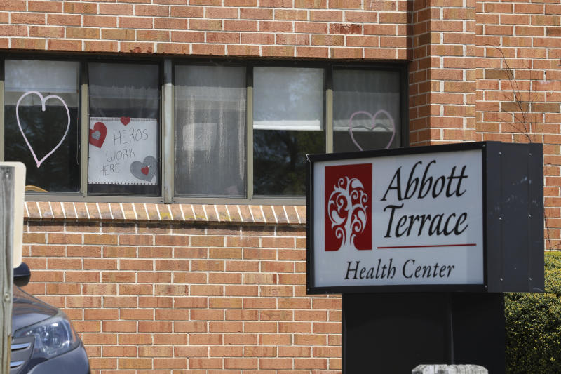 A sign for nursing home employees hangs in a window at the Abbott Terrace Health Center, Thursday, May 14, 2020 in Waterbury, Conn. The coronavirus has had no regard for health care quality or ratings as it has swept through nursing homes around the world, killing efficiently even in highly rated care centers. Preliminary research indicates the numbers of nursing home residents testing positive for the coronavirus and dying from COVID-19 are linked to location and population density — not care quality ratings. (AP Photo/Chris Ehrmann)