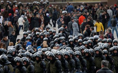 Law enforcement officers gather as they block  opposition supporters in Moscow, Russia