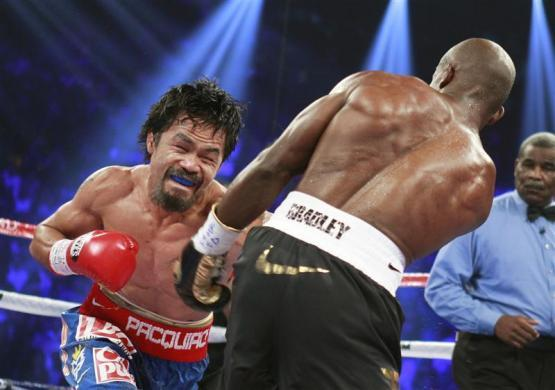 Manny Pacquiao, $67 million: WBO welterweight champion Manny Pacquiao (L) of the Philippines punches at Timothy Bradley Jr. of the U.S. during their title fight at the MGM Grand Garden Arena in Las Vegas, Nevada June 9, 2012.