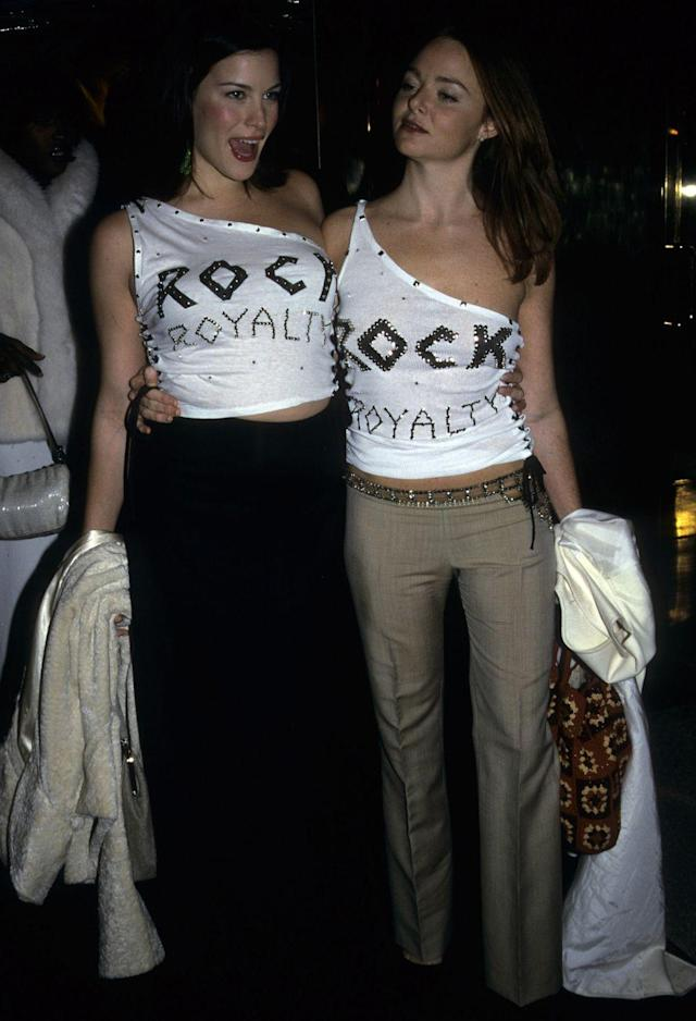 """<p>Rock runs in the bloodline for these two. For the 1999 theme, Tyler and McCartney bypassed the gowns and went for a simpler statement in bedazzled off-the-shoulder tees, which read """"rock royalty."""" </p>"""