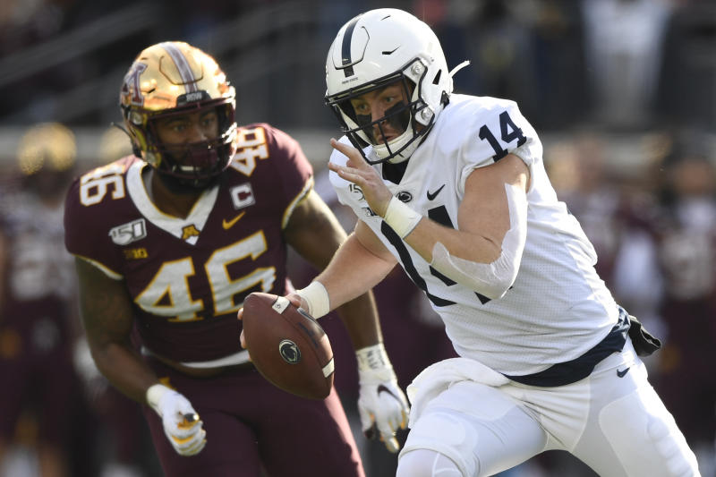 Penn State quarterback Sean Clifford (14) runs against the Minnesota Golden Gophers on Nov. 9, 2019. (Hannah Foslien/Getty Images)