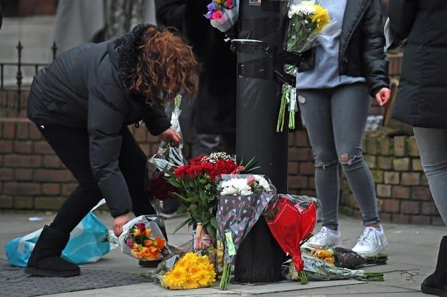 Floral tributes were left at the scene (Kirsty O'Connor/PA)