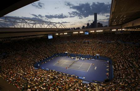 The sun sets over Rod Laver Arena during the men's singles match between Rafael Nadal of Spain and Bernard Tomic of Australia at the Australian Open 2014 tennis tournament in Melbourne January 14, 2014. REUTERS/David Gray