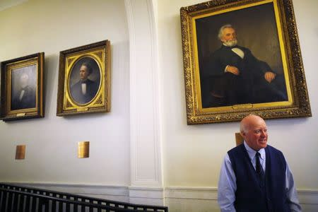 New Hampshire Secretary of State Bill Gardner stands in the hallway outside his office at the State House in Concord, New Hampshire December 17, 2014. REUTERS/Brian Snyder