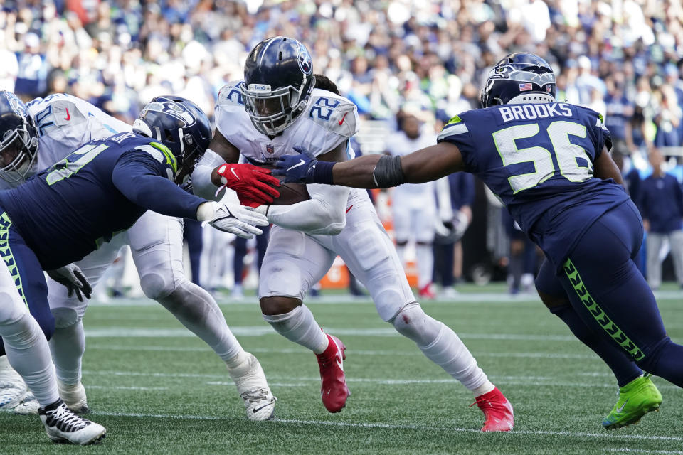 Tennessee Titans running back Derrick Henry is stopped just short of the goal line by Seattle Seahawks linebacker Jordyn Brooks (56) and Seattle Seahawks defensive end Kerry Hyder (51) during the second half of an NFL football game, Sunday, Sept. 19, 2021, in Seattle. Henry scored on the next play and the extra point was good to tie the game at 30. (AP Photo/Elaine Thompson)