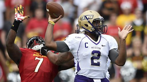 James Madison quarterback Vad Lee (2) looks to pass as he is pressured by Maryland linebacker Yannick Ngakoue (7) during the first half of an NCAA college football game, Saturday, Aug. 30, 2014, in College Park, Md. (AP Photo/Nick Wass)