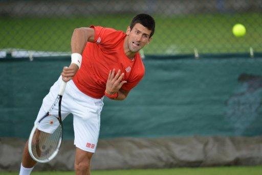 Serbia's Novak Djokovic, seen here on June 24, heads for Wimbledon with the burden of history now off his shoulders after his bid to become just the third man to hold all four Grand Slam titles at once was shattered by Rafael Nadal in Paris