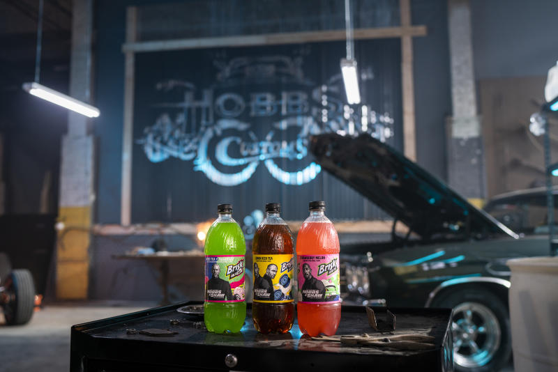 "New custom-designed Brisk Iced Tea labels on set of ""How Do You Open A Can of Whup Ass?"""