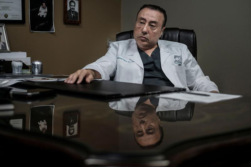 Dr. Mohamad Hakim in his office in Dearborn.