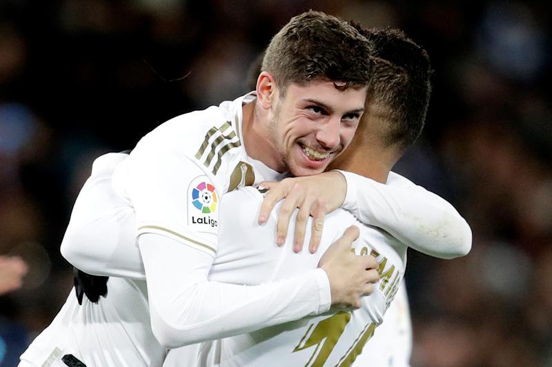 MADRID, SPAIN - NOVEMBER 23: Federico Valverde of Real Madrid celebrates 2-1 with Casemiro of Real Madrid during the La Liga Santander match between Real Madrid v Real Sociedad at the Santiago Bernabeu on November 23, 2019 in Madrid Spain (Photo by David S. Bustamante/Soccrates/Getty Images)