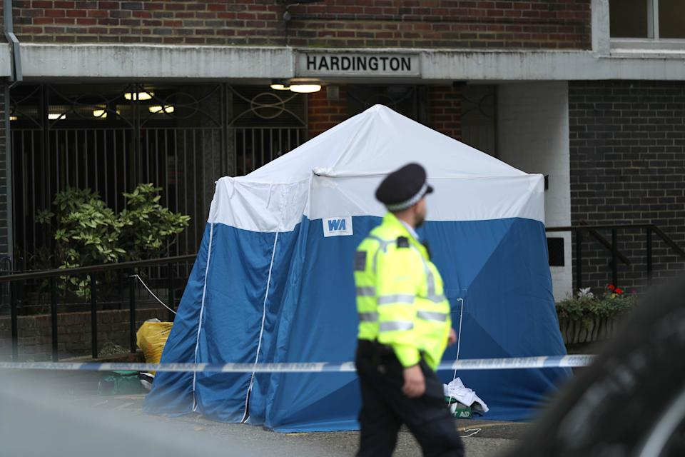 A police tent at the scene on Belmont Street, Camden, north-west London, where a woman, believed to be in her 20s, was stabbed to death late on Sunday night.
