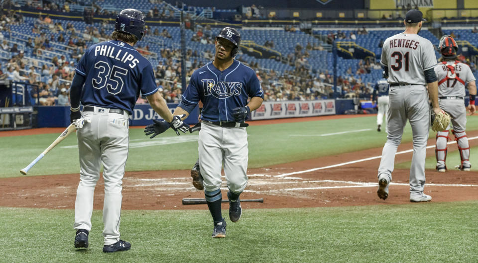 Tampa Bay Rays' Brett Phillips (35) congratulates Francisco Mejia scores on Taylor Walls RBI-single off Cleveland Indians starter Sam Hentges (31) during the second inning in the second baseball game of a doubleheader Wednesday, July 7, 2021, in St. Petersburg, Fla.(AP Photo/Steve Nesius)