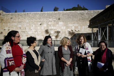 """Members of activist group """"Women of the Wall"""" speak to the media following the Israeli government's approval to create a mixed-sex prayer plaza near Jerusalem's Western Wall, in Jerusalem's Old City"""