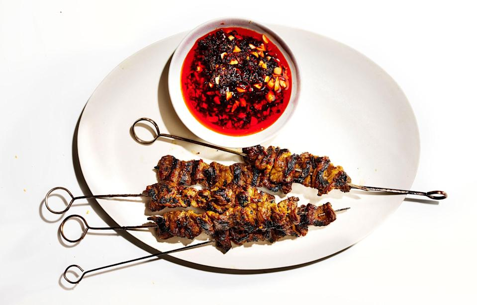 "Don't braise your short ribs—grill them. They're intensely beefy, with gorgeous marbling that encourages crispy bits. <a href=""https://www.bonappetit.com/recipe/coconut-marinated-short-rib-kebabs-peanut-chile-oil?mbid=synd_yahoo_rss"" rel=""nofollow noopener"" target=""_blank"" data-ylk=""slk:See recipe."" class=""link rapid-noclick-resp"">See recipe.</a>"