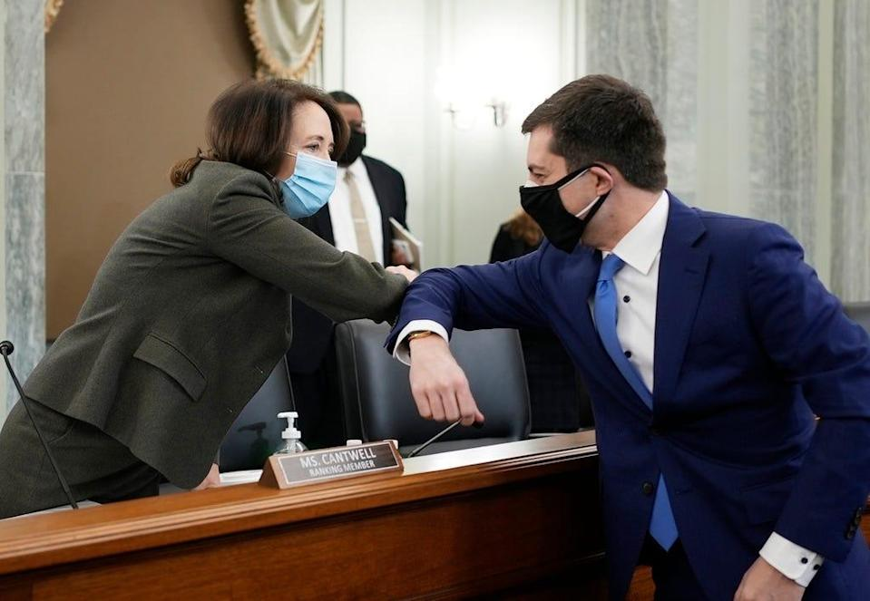 Sen. Maria Cantwell, D-Wash., greets Pete Buttigieg at the Senate Commerce, Science, and Transportation nomination hearings Thursday to consider Buttigieg's nomination to be Secretary of Transportation.