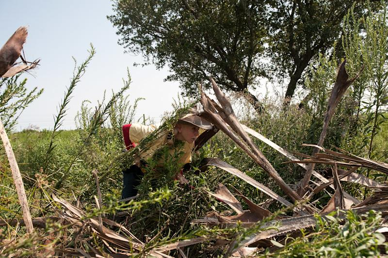 A member of Texas EquuSearch searches for missing realtor Crystal McDowell. (Joseph Rushmore for HuffPost)