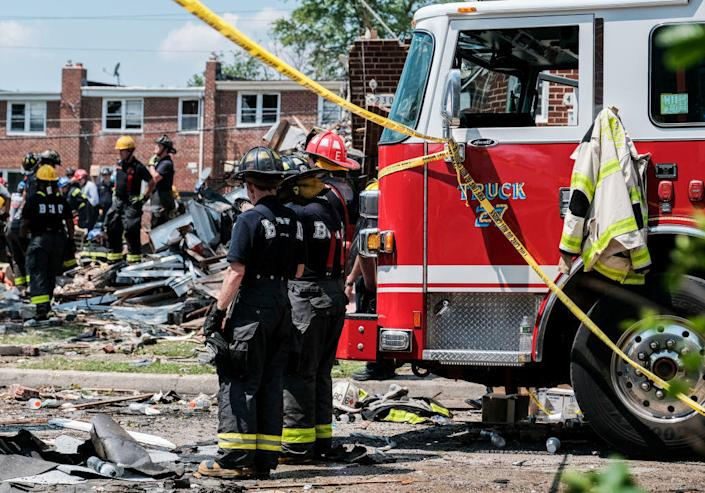First responders search for survivors at the scene of an explosion on August 10, 2020, in Baltimore. / Credit: Michael A. McCoy / Getty
