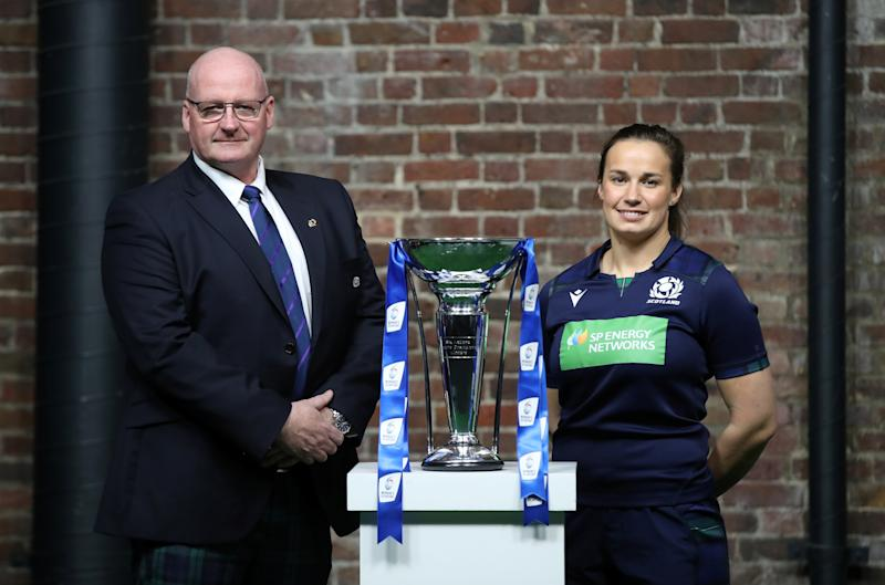Scotland head coach Philip Doyle and Scotland's Rachel Malcolm pose with the Six Nations trophy Action Images via Reuters/Peter Cziborra