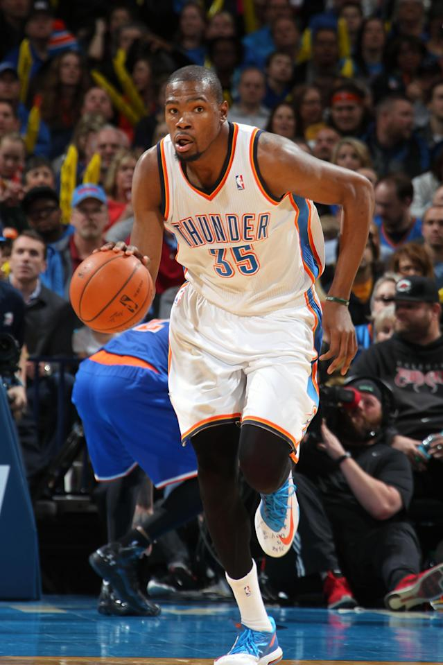 OKLAHOMA CITY, OK - FEBRUARY 9 : Kevin Durant #35 of the Oklahoma City Thunder moves the ball up-court against the New York Knicks on February 9, 2014 at the Chesapeake Energy Arena in Oklahoma City, Oklahoma. (Photo by Layne Murdoch Jr./NBAE via Getty Images)
