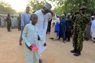 A man reacts as he receives his son, who was rescued by the Nigerian security forces in Katsina