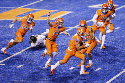 Boise State linebacker DJ Schramm (52) runs with the ball for a touchdown after recovering a blocked Colorado State punt during the first half of an NCAA college football game Thursday, Nov. 12, 2020, in Boise, Idaho. (AP Photo/Steve Conner)