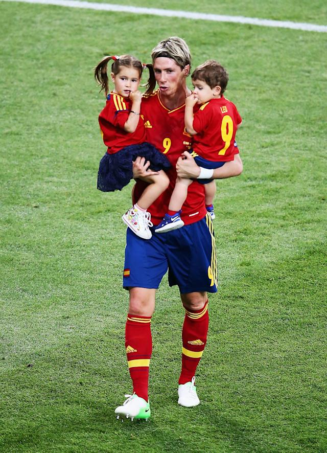 KIEV, UKRAINE - JULY 01: Fernando Torres of Spain holds his children Nora Torres (L) and Leo Torres (R) after the UEFA EURO 2012 final match between Spain and Italy at the Olympic Stadium on July 1, 2012 in Kiev, Ukraine. (Photo by Martin Rose/Getty Images)