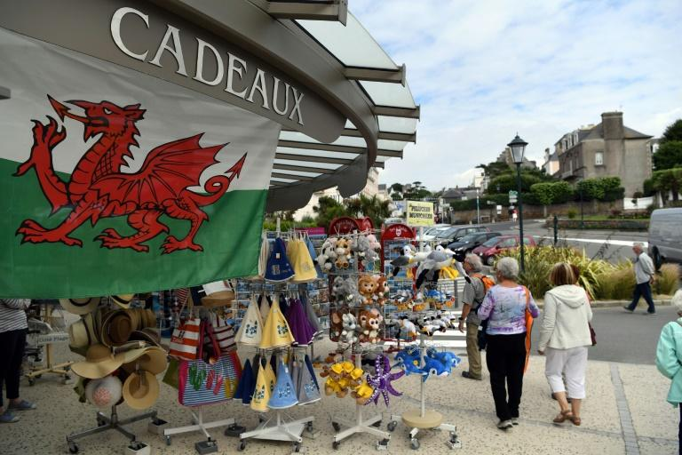 The Welsh flag hangs above a souvenir shop in Dinard, western France, on July 4, 2016 (AFP Photo/Paul Ellis)