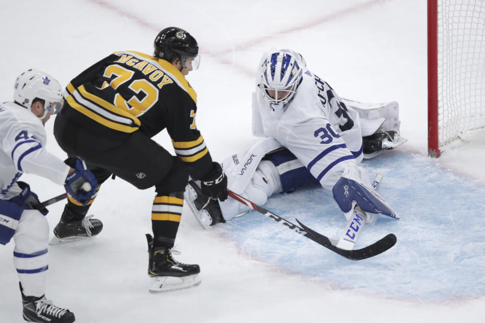 Toronto Maple Leafs goaltender Michael Hutchinson (30) makes a save on a shot by Boston Bruins defenseman Charlie McAvoy (73) during the first period of an NHL hockey game in Boston, Tuesday, Oct. 22, 2019. (AP Photo/Charles Krupa)