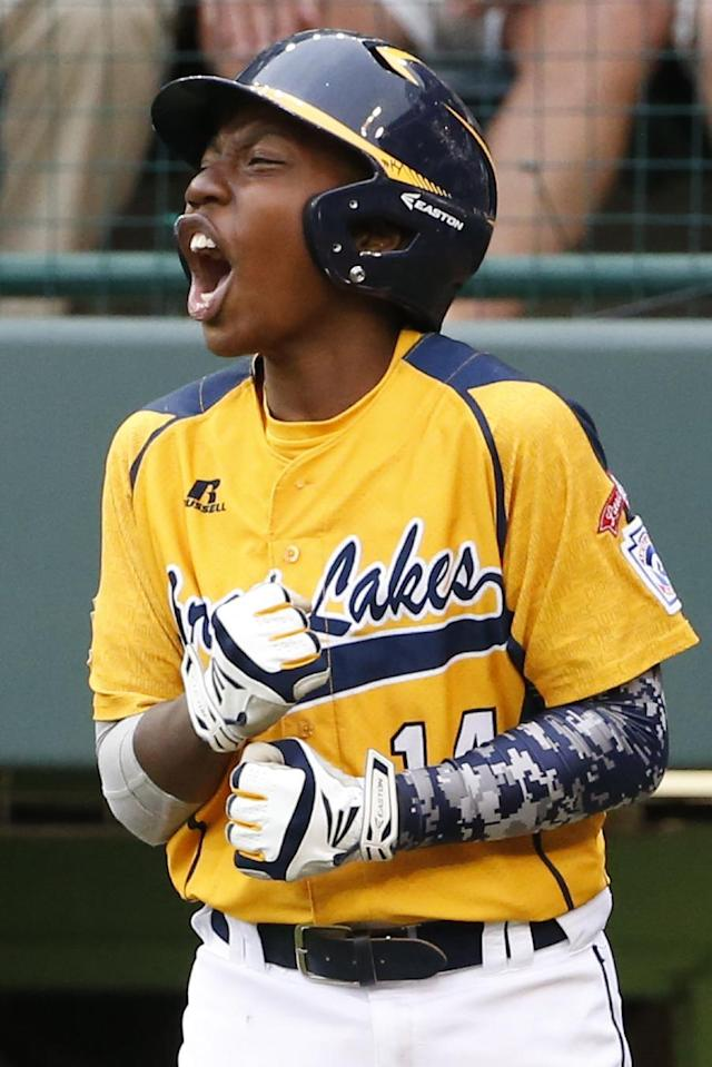 Chicago's Brandon Green (14) celebrates after scoring on a single by Ed Howard off Las Vegas' Zach Hare in the fifth inning of the United States Championship game at the Little League World Series in South Williamsport, Pa., Saturday, Aug. 23, 2014. Chicago won 7-5. (AP Photo/Gene J. Puskar