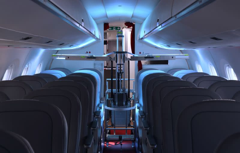 A robot developed by Swiss company UVeya armed with virus-killing ultraviolet light is seen aboard an airplane at Zurich AIrport