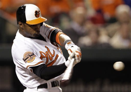 Baltimore Orioles' Adam Jones hits a solo home run in the eighth inning of a baseball game against the Toronto Blue Jays in Baltimore, Thursday, April 26, 2012. Baltimore won 5-2. (AP Photo/Patrick Semansky)