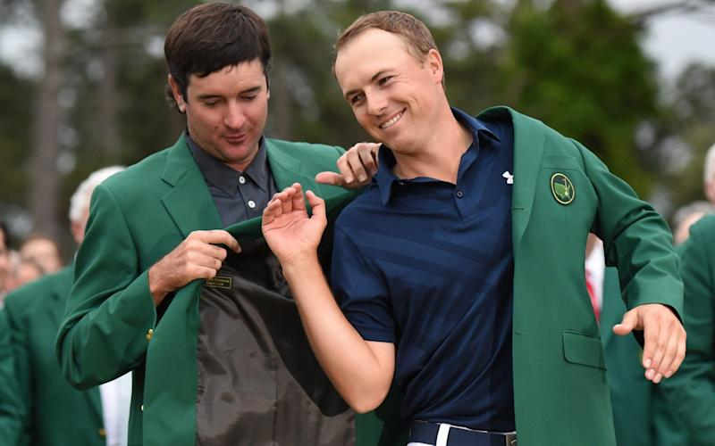 Bubba Watson helps Jordan Spieth put on his green jacket in 2015 - AFP