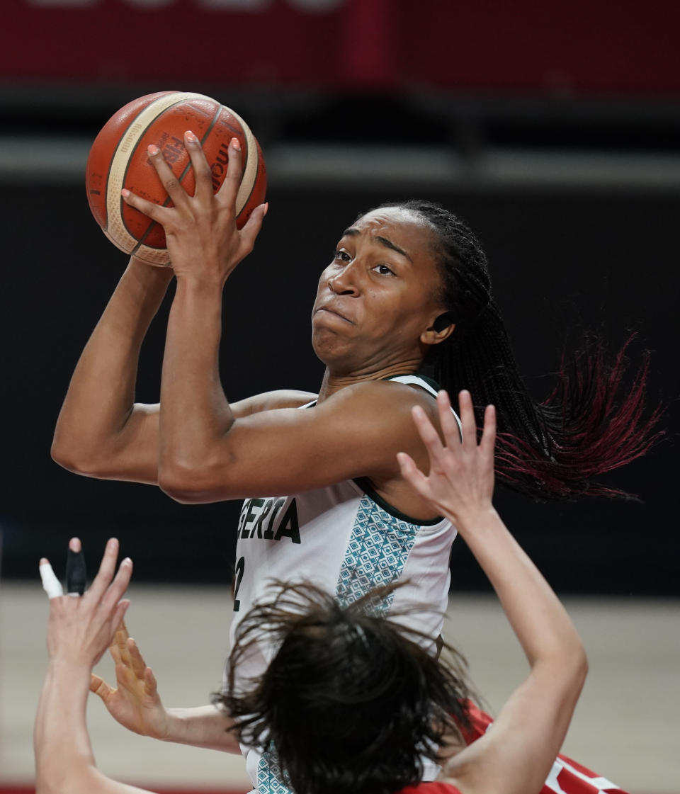 Nigeria's Oderah Chidom (22) shoots over Japan's Naho Miyoshi (12) during women's basketball preliminary round game at the 2020 Summer Olympics, Monday, Aug. 2, 2021, in Saitama, Japan. (AP Photo/Charlie Neibergall)