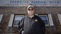 Paul Guilbeault, quartermaster at Veterans of Foreign Wars Post #3260, poses outside the building former home of the post, Friday, March 12, 2021, in New Bedford, Mass. Guilbeault knew the writing was on the wall for the last Veterans of Foreign Wars post in this city south of Boston when businesses across Massachusetts were ordered to close as the coronavirus pandemic took hold last March. (AP Photo/Charles Krupa)