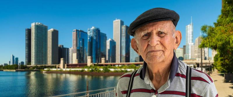 Elderly 80 plus year old man outdoor portrait with the Chicago skyline in the background.
