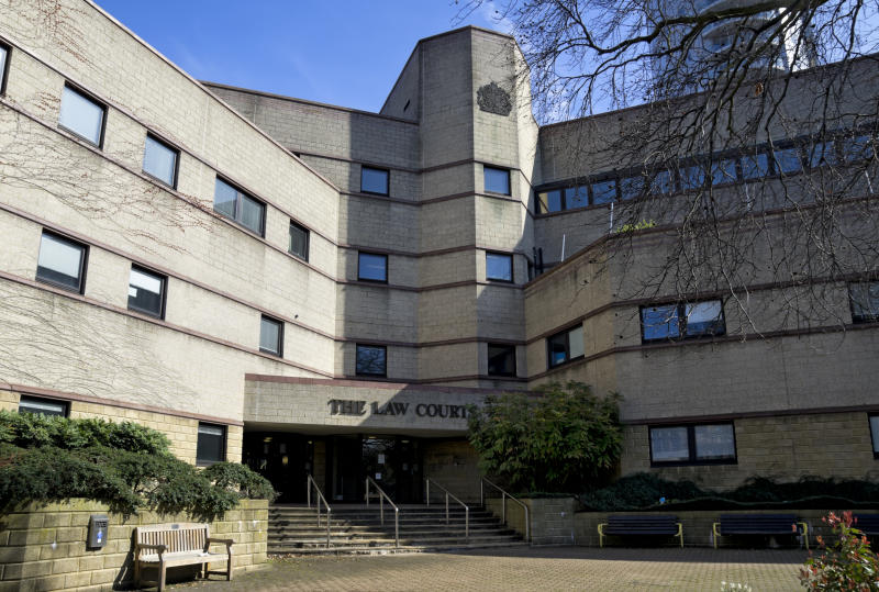 """Croydon, Surrey, England - March 25, 2012: The Law Courts in Croydon, Surrey. The courts complex comprises the Magistrates' Court, Coroner's Court, Youth Court, Family Court, County Court and Crown Court."""