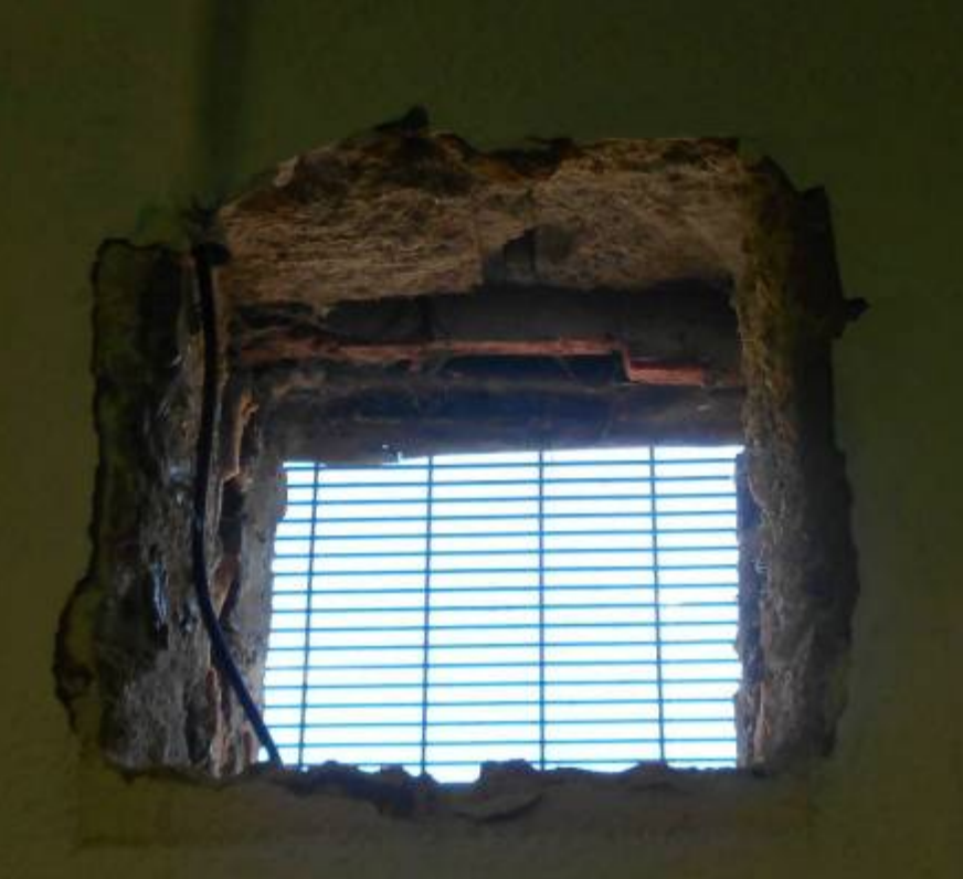 <p>A hole to the outside in the wall of an occupied cell. (Life in prison: Living conditions report) </p>
