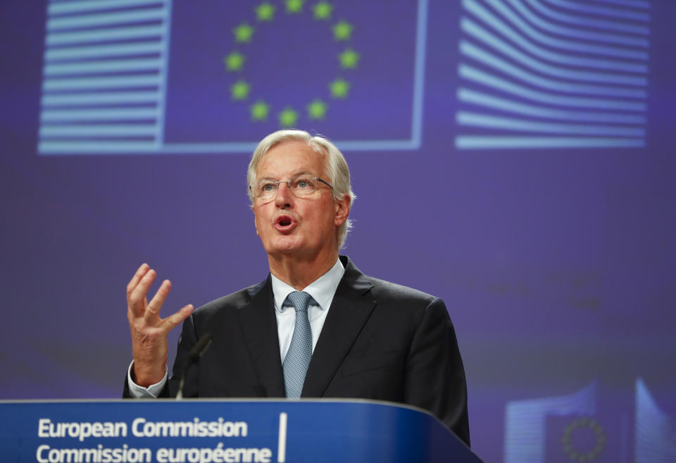 European Union chief Brexit negotiator Michel Barnier looks at his watch prior to speaking during a media conference at EU headquarters in Brussels, Thursday, Oct. 17, 2019. The European Union says Brexit negotiations are plowing on after intense talks in recent days, as EU leaders converge on Brussels for a key summit aimed at sealing a new divorce agreement. (AP Photo/Frank Augstein)