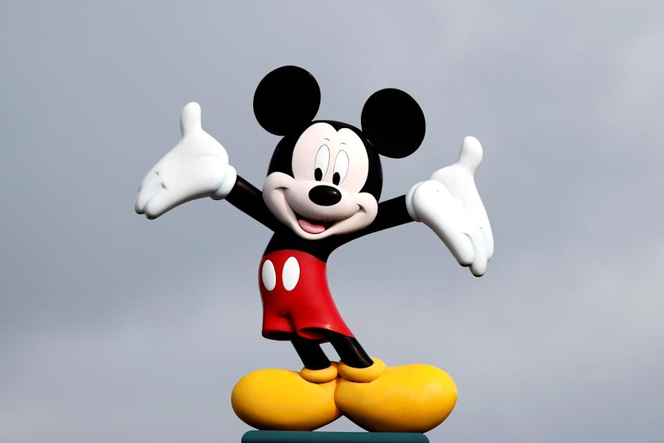 Disney character Mickey Mouse is seen above the entrance of Disneyland Paris, in Marne-la-Vallee, near Paris, France, March 9, 2020, where a maintenance worker was tested positive for coronavirus over the weekend.  REUTERS/Benoit Tessier