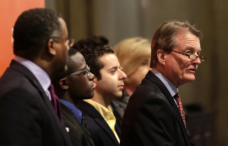 University of Texas president Bill Powers, right, address questions during a news conference, Monday, June 24, 2013, in Austin, Texas. Affirmative action in college admissions survived Supreme Court review Monday in a consensus decision that avoided the difficult constitutional issues surrounding a challenge to the University of Texas admission plan.(AP Photo/Eric Gay)