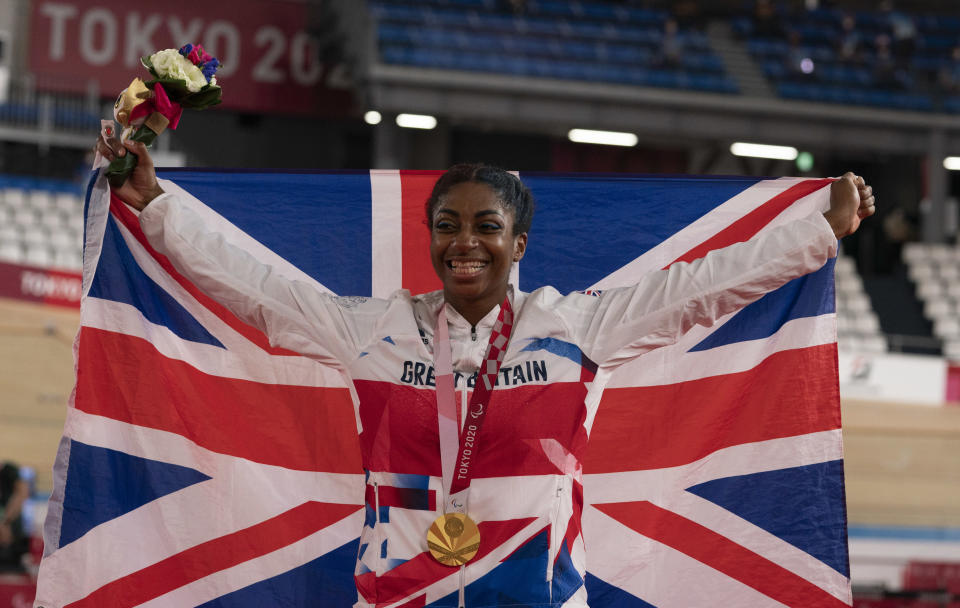 Kadeena Cox, 30, celebrates after defending her C4-5 500m time trial Paralympic title (Credit: imagecomms)