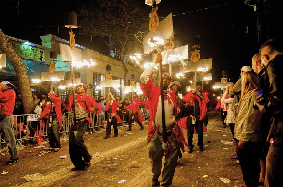 <p>These torch-bearers light the way for parades while providing entertainment through captivating spins and twirls. The tradition dates back to 1857 and is still practiced in Mardi Gras parades today.</p>