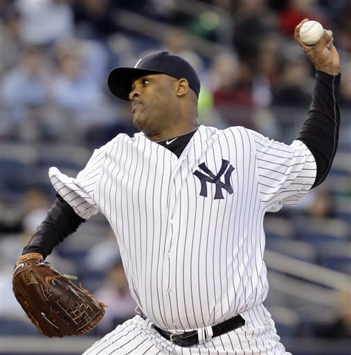 New York Yankees starting pitcher CC Sabathia winds up in the first inning against the Tampa Bay Rays during their baseball game at Yankee Stadium in New York, Thursday, May 10, 2012. (AP Photo/Kathy Willens)