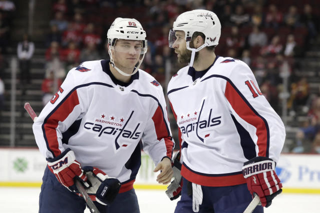 Washington Capitals left wing Andre Burakovsky, of Austria,, left, stands with teammate right wing Brett Connolly after scoring a goal on the New Jersey Devils during the first period of an NHL hockey game, Tuesday, March 19, 2019, in Newark, N.J. (AP Photo/Julio Cortez)