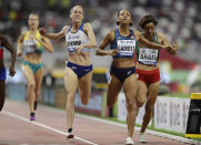 From right, Rababe Arafi of Morocco, Renelle Lamote of France and Britain's Lynsey Sharp compete during the women's 800 meters heats at the World Athletics Championships in Doha, Qatar, Friday, Sept. 27, 2019. (AP Photo/Petr David Josek)