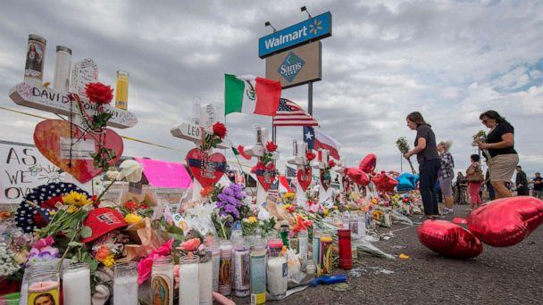 PHOTO: People leave flowers at a makeshift memorial for shooting victims at the Cielo Vista Mall Walmart, in El Paso, Texas, August 6, 2019. (Mark Ralston/AFP/Getty Images)