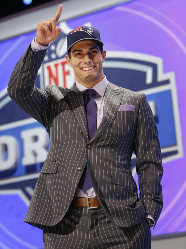 Eastern Illinois quarterback Jimmy Garoppolo reacts after being selected as the 62nd pick by the New England Patriots in the second round of the 2014 NFL Draft, Friday, May 9, 2014, in New York. (AP Photo/Jason DeCrow)
